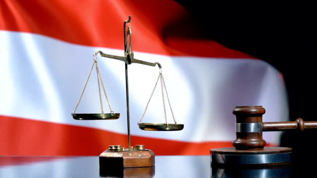 balance and gavel with austrian flag - sentencing stock videos & royalty-free footage
