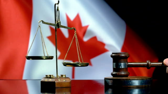 balance and gavel with canadian flag - gavel stock videos & royalty-free footage