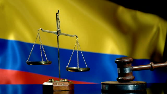 balance and gavel with colombian flag - medellin colombia stock videos & royalty-free footage