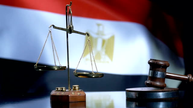 balance and gavel with egyptian flag - egypt stock videos & royalty-free footage