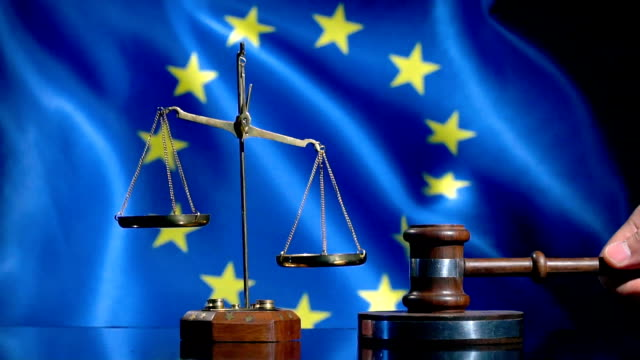 balance and gavel with european union flag - hammer stock videos and b-roll footage