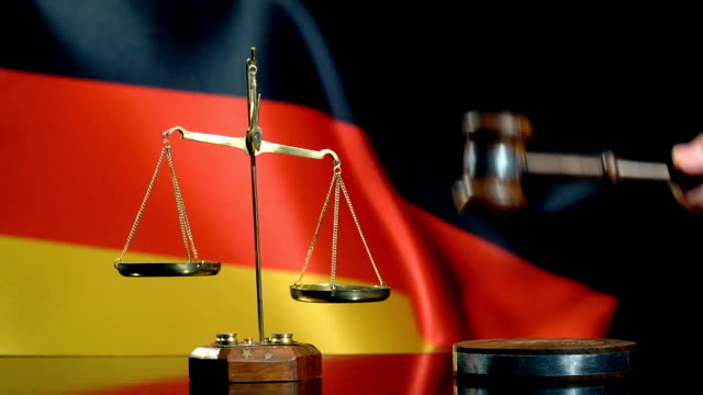 balance and gavel with german flag - nazism stock videos & royalty-free footage