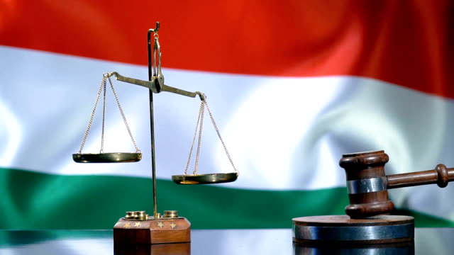 balance and gavel with hungarian flag - eastern european culture stock videos & royalty-free footage