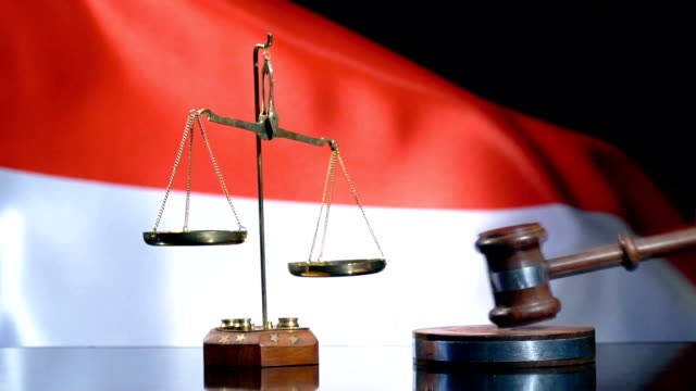 balance and gavel with indonesian flag - sentencing stock videos & royalty-free footage