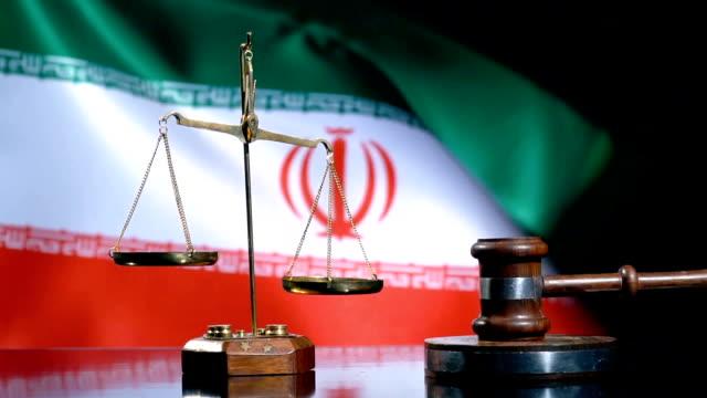 balance and gavel with iran flag - iran stock videos & royalty-free footage