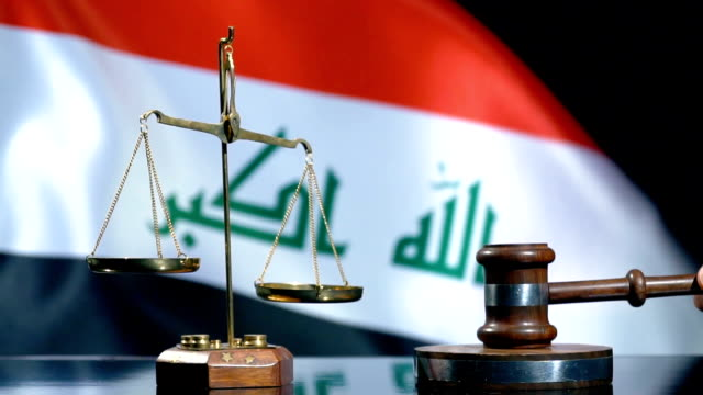 balance and gavel with iraqi flag - iraqi flag stock videos and b-roll footage