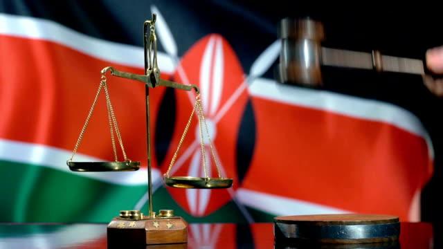 balance and gavel with kenyan flag - kenyan flag stock videos & royalty-free footage