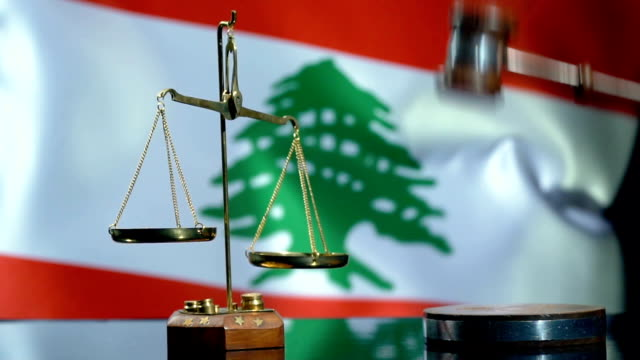 balance and gavel with lebanese flag - lebanese ethnicity stock videos and b-roll footage