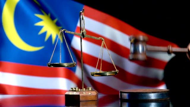 balance and gavel with malaysian flag - malaysia stock videos & royalty-free footage