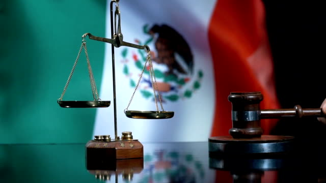 balance and gavel with mexican flag - decisions stock videos & royalty-free footage