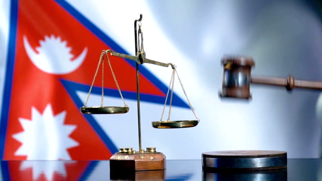 balance and gavel with nepali flag - nepali flag stock videos & royalty-free footage