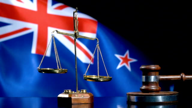 balance and gavel with new zealand flag - new zealand culture stock videos & royalty-free footage