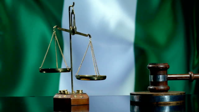balance and gavel with nigerian flag - nigerian flag stock videos & royalty-free footage