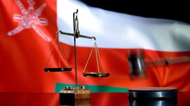 balance and gavel with omani flag - oman flag stock videos and b-roll footage