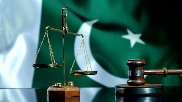 balance and gavel with pakistani flag - pakistani flag stock videos & royalty-free footage
