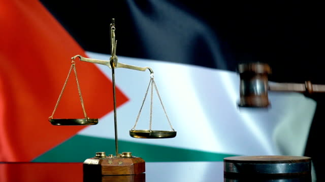 balance and gavel with palestinian flag - palestinian stock videos & royalty-free footage