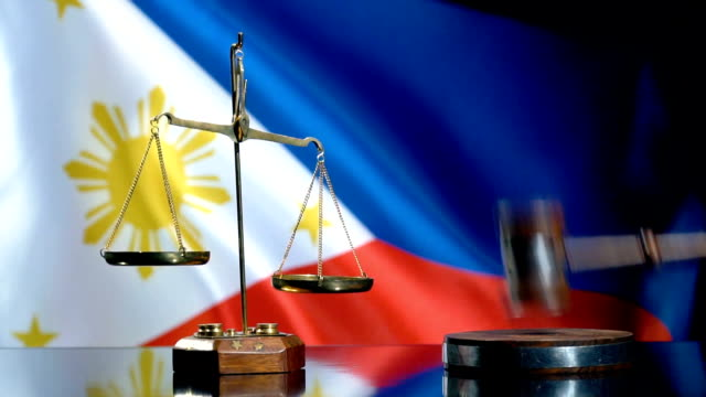 balance and gavel with philippines flag - philippines flag stock videos & royalty-free footage