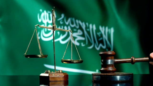 balance and gavel with saudi arabian flag - saudi arabia stock videos & royalty-free footage