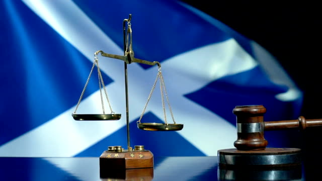 balance and gavel with scottish flag - courthouse stock videos & royalty-free footage