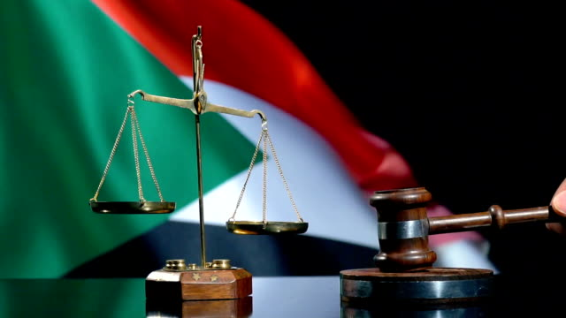 balance and gavel with sudanese flag - sorghum stock videos & royalty-free footage