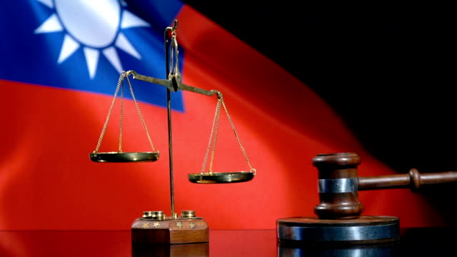 balance and gavel with taiwanese flag - taiwanese flag stock videos & royalty-free footage
