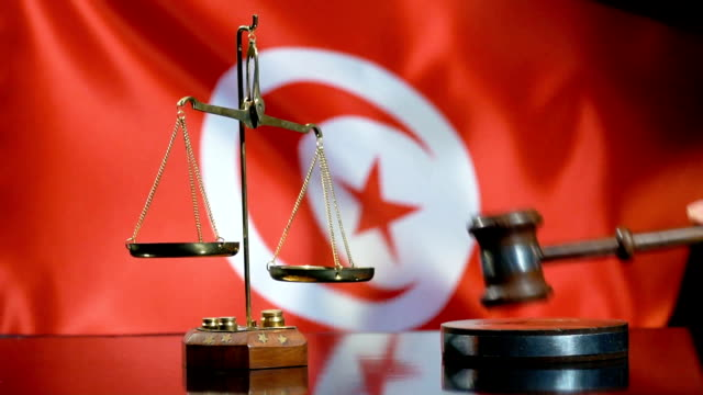 balance and gavel with tunisian flag - justice concept stock videos & royalty-free footage