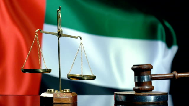 balance and gavel with united arab emirates flag - legal system stock videos & royalty-free footage