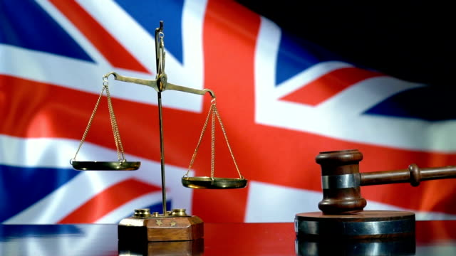 balance and gavel with united kingdom flag - english culture stock videos & royalty-free footage