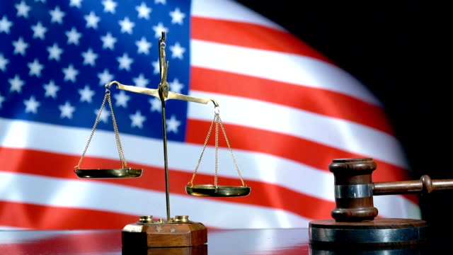balance and gavel with united states flag - courthouse stock videos & royalty-free footage