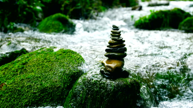 balance and harmony stone in nature - balance stock videos & royalty-free footage