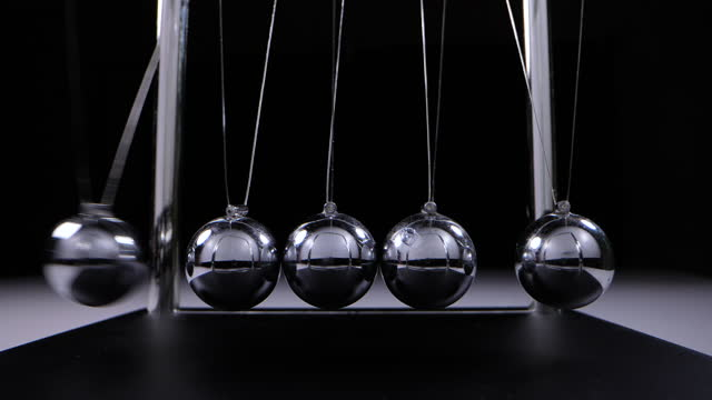 balance newton's cradle ball in slow motion - five objects stock videos & royalty-free footage
