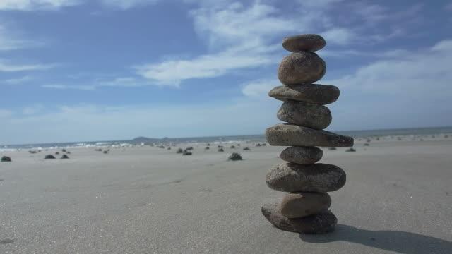 balance stone on the beach