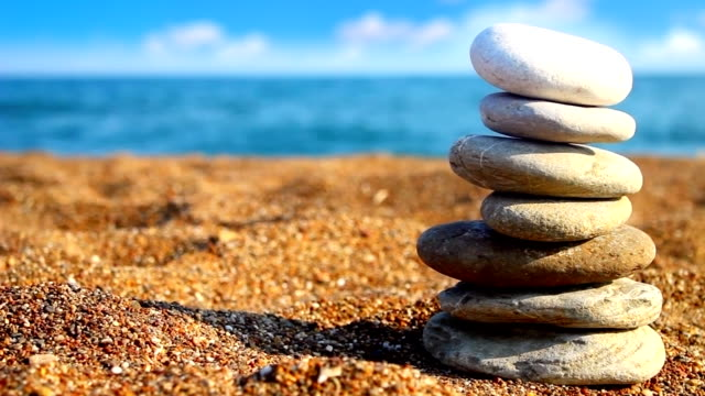 balance stones (loopable) - stack rock stock videos and b-roll footage