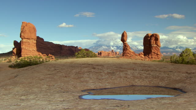 Balanced Rock at Arches National Park with dramatic cloudy timelapse shadows