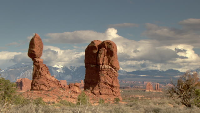 Balanced Rock with dramatic coulds in background - zoom in from wide shot