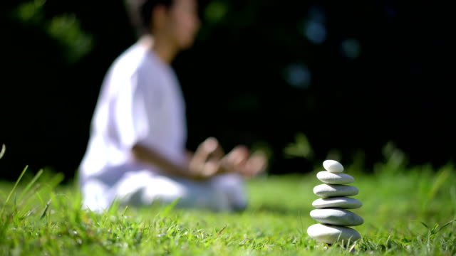 tu balanced rocks, meditating man as background - cross legged stock videos & royalty-free footage