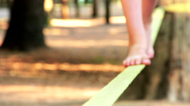 balancing barefoot on a slackline - balance stock videos & royalty-free footage