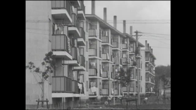 balconies line apartment buildings in sapporo. - fönsterrad bildbanksvideor och videomaterial från bakom kulisserna