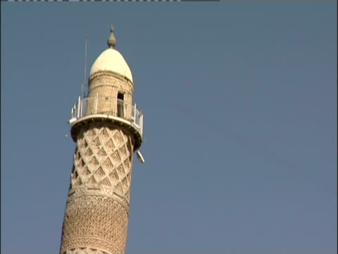 a balcony encircles the uppermost window of a minaret. - iraq stock videos and b-roll footage