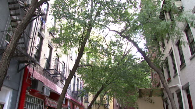 a balcony hangs above a mexican restaurant near a new york city street. - mexican restaurant stock videos & royalty-free footage