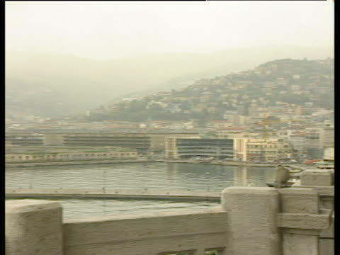stockvideo's en b-roll-footage met balcony of building pigeon on railings pan left to large car ferry in dock trieste - 1992