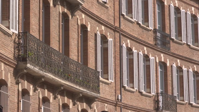 balcony & windows of brick houses - toulouse stock videos & royalty-free footage