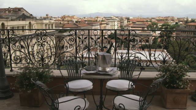WS DS. PAN Balcony with champagne on table / Rome, Italy