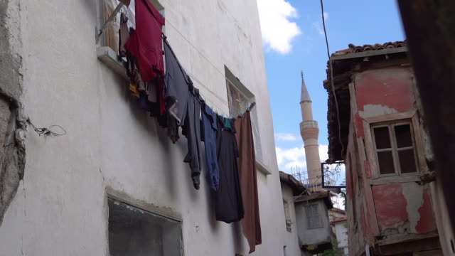 balcony with hanging laundry in turkey - clothesline stock videos & royalty-free footage