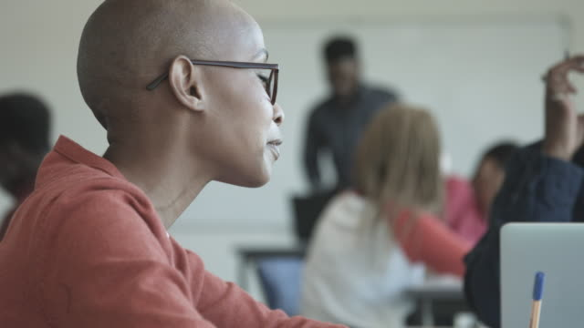 bald african american student in classroom, close up - completely bald stock videos & royalty-free footage