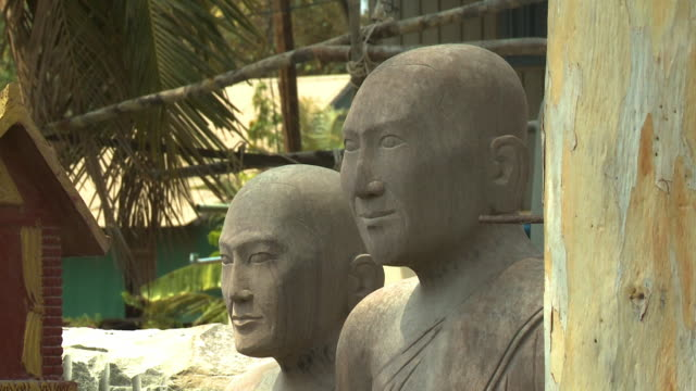 bald human stone sculptures in san tok, cambodia - effigy stock videos & royalty-free footage