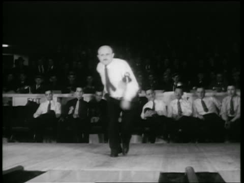 b/w 1938 bald man throwing ball down lane of bowling alley in tournament / chicago / newsreel - bowling ball stock videos & royalty-free footage