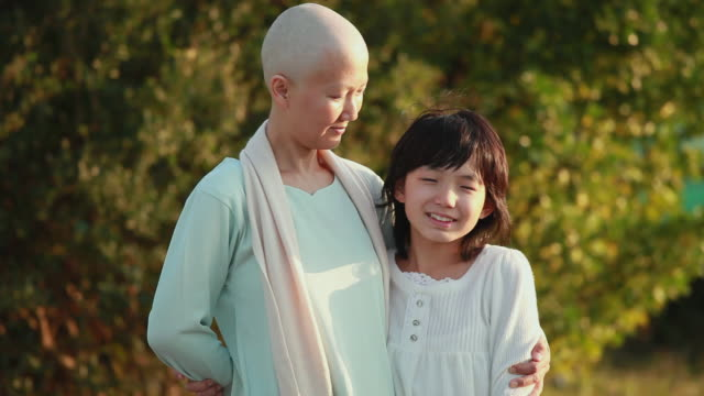 ms bald woman hugging daughter (11-12) standing outdoors / urayasu, chiba, japan - hair loss stock videos & royalty-free footage