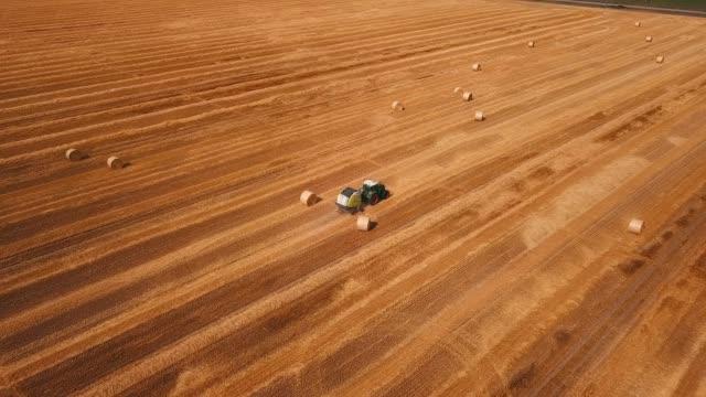 Baler making straw bales