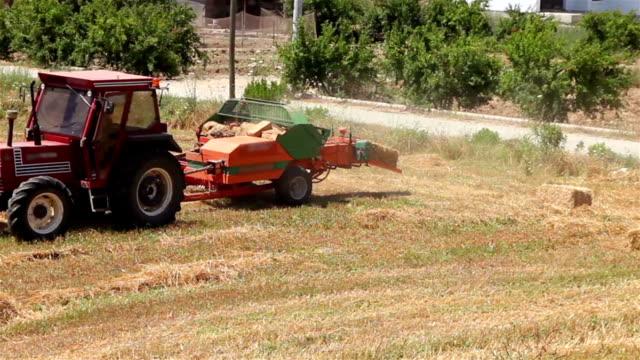 baler making straw bales - haystack stock videos & royalty-free footage